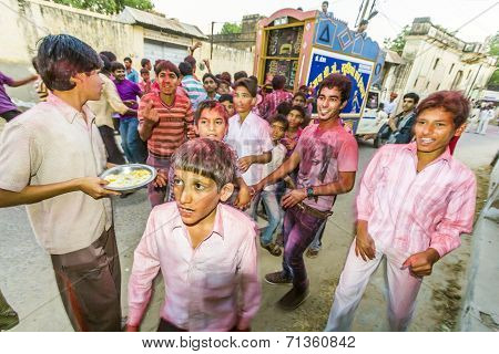 People Throw Colors To Each Other During The Holi Celebration