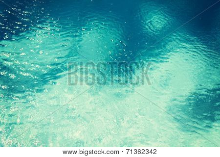 travel, vacation and background concept - water in pool, sea or ocean