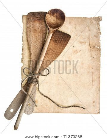 Vintage Wooden Kitchen Utensils And Old Cookbook Page