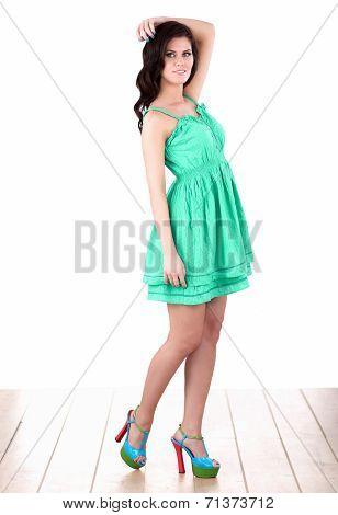 Fashion woman standing  in green dress