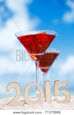 2015 letters with  red drink on beach , ocean ,white sand beach and seascape