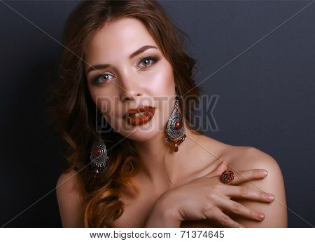 Portrait of young beautiful brunette woman in ear-rings