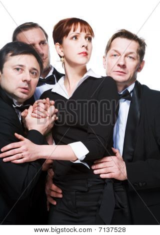 Three Men In Tuxedos And Cheerful Girl