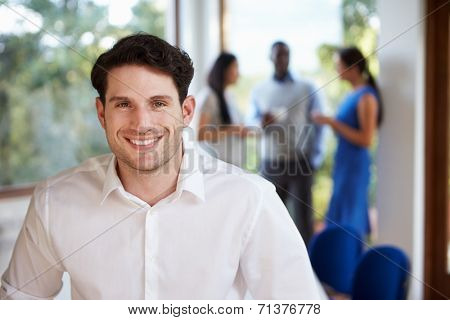 Casually Dressed Businessman Attending Meeting In Boardroom