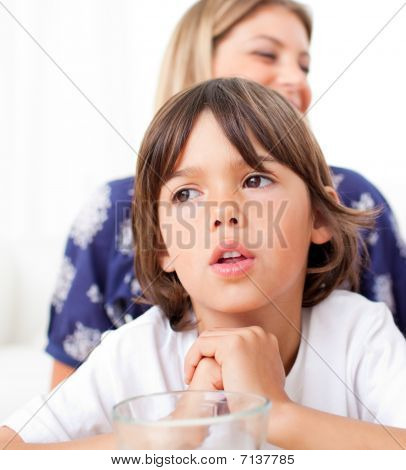 Captivated Child Watching Television With His Mother