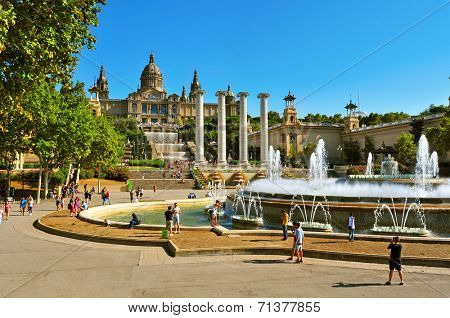 BARCELONA, SPAIN - AUGUST 16: The Magic Fountain and Palau Nacional in Montjuic on August 16, 2014 in Barcelona, Spain. All the area, built for the 1929 International Exposition, is a popular landmark