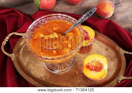 tasty apricot jam with fresh apricots on wooden table