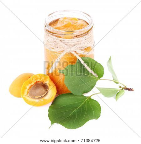 tasty apricot jam with fresh apricots, isolated on white