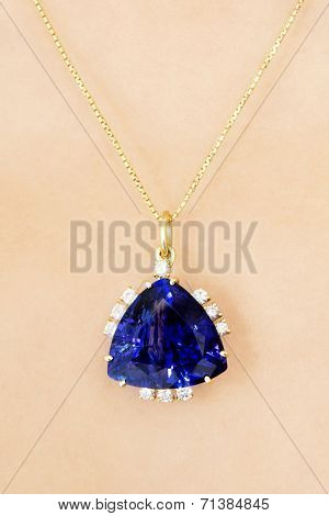 Closeup of Designer Pendant with Tanzanite and Diamonds on Caucasian Skin