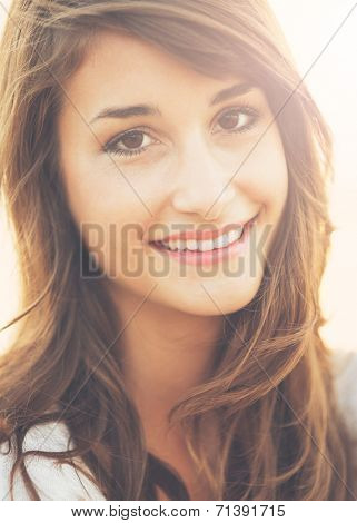 Portrait of Beautiful Happy Young Woman Smiling, Warm soft color tone