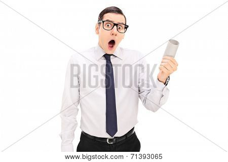 Outraged person holding an empty toilet paper roll isolated on white background
