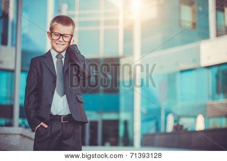 kid businessman talking on the phone