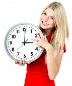 image of daylight-saving  - young woman holding a clock - JPG