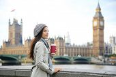 stock photo of westminster bridge  - London woman drinking coffee by Westminster Bridge - JPG