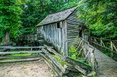 picture of cade  - The Cable Grist Mill in Cades Cove is one of many historical structures located within the Great Smoky Mountains National Park - JPG