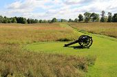 pic of artillery  - Old artillery weapon set in meadow where wars were fight during The American Revolution - JPG