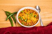 pic of poblano  - A bowl of chili con carne with beans and green chili peppers - JPG