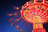 image of carnival ride  - a fair ride during dusk on a warm summer evening - JPG