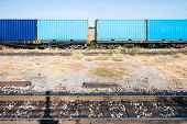 stock photo of boxcar  - container wagon of freight train in the city station - JPG