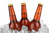 foto of condensation  - Three beer bottles in ice with condensation isolated on white background - JPG