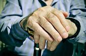 stock photo of memory stick  - closeup of the hands of an old man with a walking stick - JPG