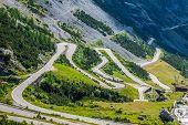 foto of italian alps  - serpentine mountain road in Italian Alps Stelvio pass Passo dello Stelvio Stelvio Natural Park - JPG