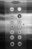 stock photo of elevators  - silver elevator panel have number 1 to 8 floor on it - JPG