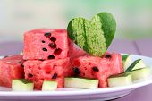 pic of watermelon slices  - Slices of watermelon on white plate on wooden table on natural background - JPG