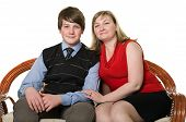 Young Mother And Teenage Son On Sofa