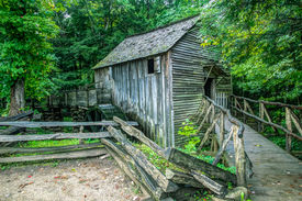 stock photo of cade  - The Cable Grist Mill in Cades Cove is one of many historical structures located within the Great Smoky Mountains National Park - JPG