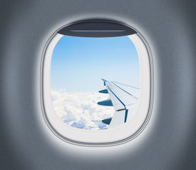 foto of aeroplan  - Airplane or aeroplane window with wing and cloudy sky behind - JPG