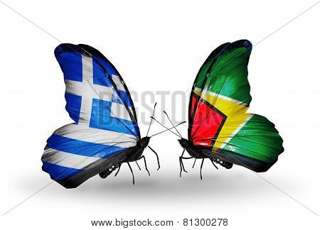 Two Butterflies With Flags On Wings As Symbol Of Relations Greece And Guyana