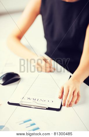 picture of woman thinking about signing a contract
