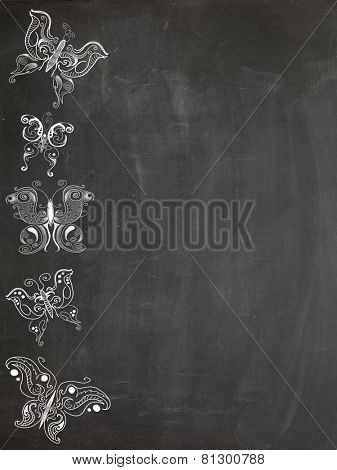 Drawings of various butterflies on chalk board