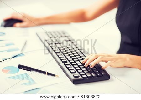 picture of woman hands typing on keyboard