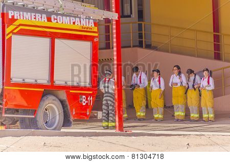 SAN PEDRO DE ATACAMA, CHILE, MAY 18, 2014: Fire brigade (mostly female) during a meeting in front of fire station