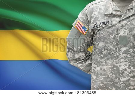 American Soldier With Flag On Background - Gabon