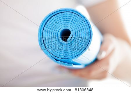 Close Up: Folded Blue Pilates Mat In Woman Hands