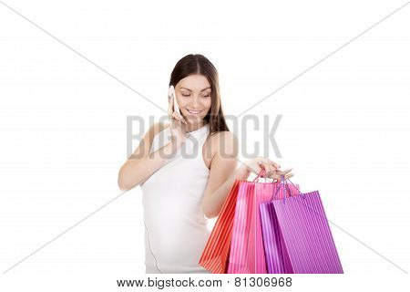 Smiling Female With Colorful Shopping Bags Making Call