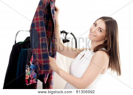 Smiling Girl Chooses Clothes
