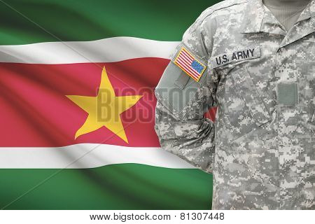 American Soldier With Flag On Background - Surinam