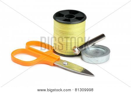 Coils threads and scissors on a white background