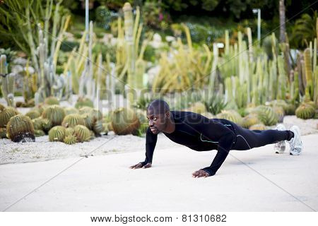 Athletic young man doing press ups before going for a run