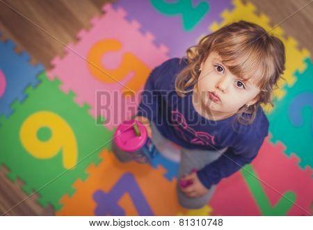 Little girl drinking water