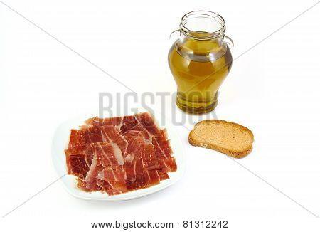 Serrano ham, bread and olive oil. Jabugo. Mediterranean diet.