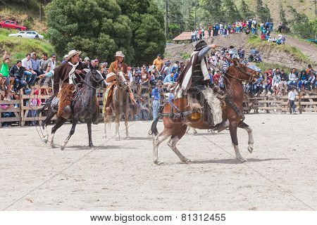 Group Of Latin Indigenous Cowboys Riding A Horse