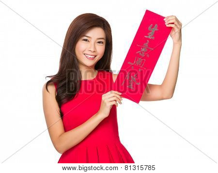 Woman hold with Fai Chun for chinese new year, phrase meaning is business prospers