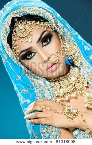 Ethnic Eastern bride in bollywood style bridal outfit