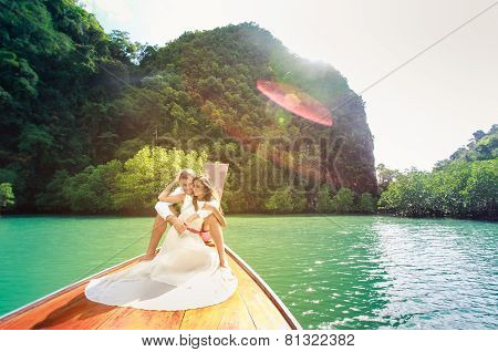 Young Groom Hugging His Brunette Bride
