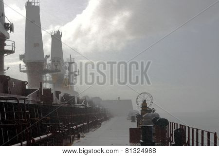 a flurry of wind and rain on the ship